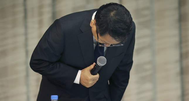 Toyota Motor Corp. President Akio Toyoda bows deeply at the start of a press conference in Tokyo Friday. Akio Toyoda said he believes American executive Julie Hamp had no intention of breaking the law.