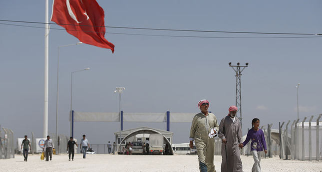 Syrian refugees walk at a refugee camp in Suruç, on the Turkey-Syria border, Friday, June 19, 2015. Ahead of World Refugee Day on Saturday, June 20, 2015 (AP Photo)