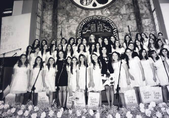 A group of adolescent girls in white dresses at Bat-Mitzvah ceremony after which they are considered accountable for their religious actions