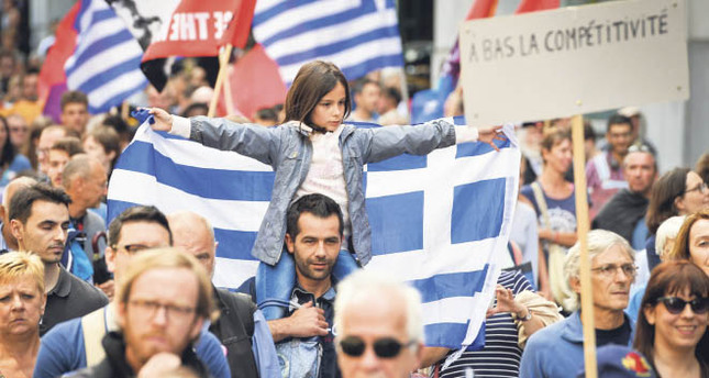 People attend a rally in support of Greeks and against austerity in Greece in Brussels on Sunday. EPA Photo