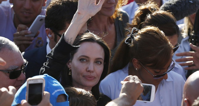 UNHCR Special Envoy Angelina Jolie (C) waves as she leaves a refugee camp in Mardin on Sunday. (AP Photo)