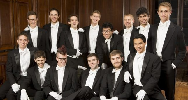 The members of the Whiffenpoofs, referenced as the world's oldest and best-known collegiate A Cappella group, appear in their tuxedos at a performance.
