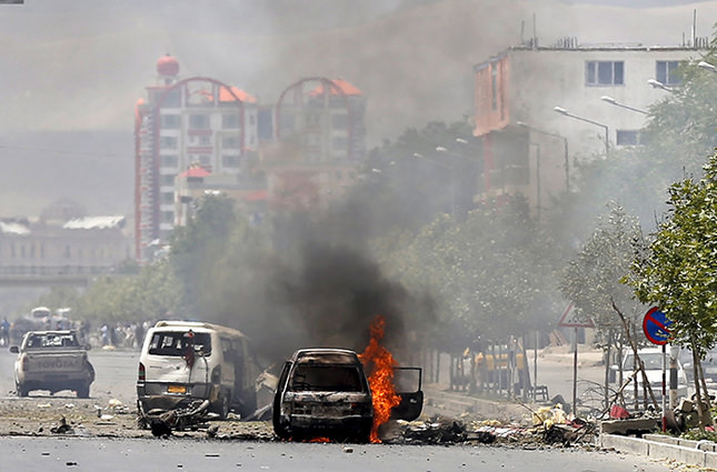 A vehicle is seen on fire after a blast near the Afghan parliament in Kabul, Afghanistan June 22, 2015 (Reuters Photo)