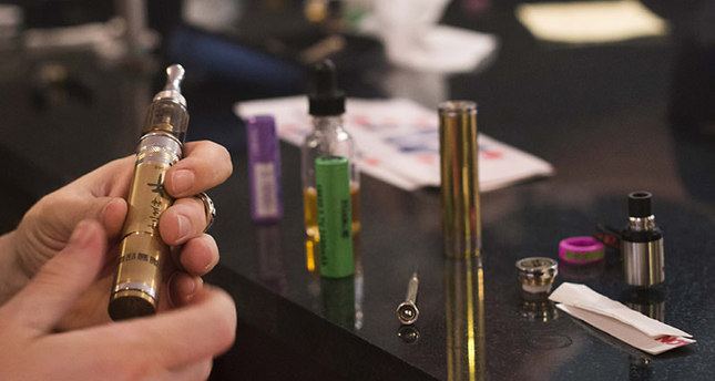 An array of mechanical mod equipment, or portable vaporizers, lies on a table ahead of a vapor cloud competition at the The Henley Vaporium in Lower Manhattan, New York on July 26, 2014 Reuters Photo