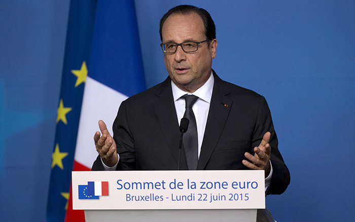 French President Francois Hollande speaks during a media conference at an EU summit in Brussels. (AP Photo)