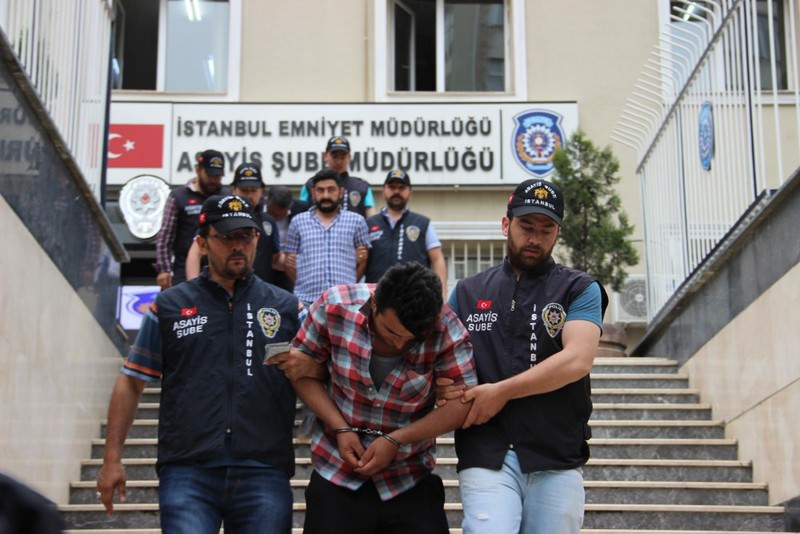 Police officers escorting  suspects detained in May for a bank robbery.  Istanbul has experienced a drop in the crime rate combined with a high rate of detentions, an improvement compared to past years.