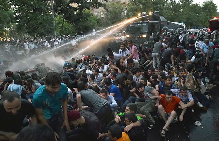 rmenian police forces use water cannons against protesting against plans of the government to raise electricity prices for up to 40 per cent, in Yerevan, Armenia (EPA Photo)