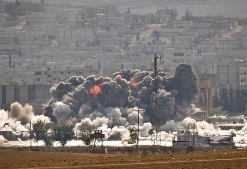 Smoke and flames rise from an ISIS position in Kobani during airstrikes by the U.S. led coalition seen from the outskirts of Suruu00e7 on Oct. 28, 2014.