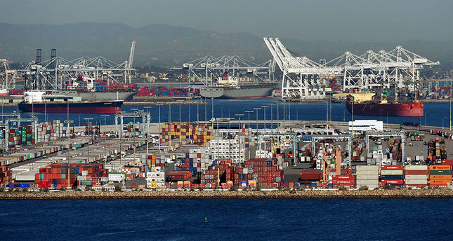 Ships wait to be loaded at the Port of Los Angeles in February (AFP Photo)
