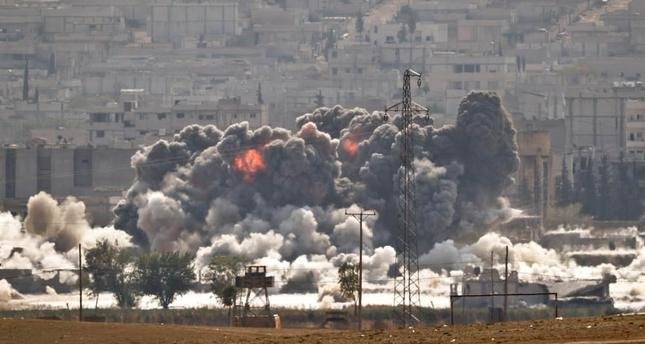 Smoke and flames rise from an ISIS position in Kobani during airstrikes by the U.S. led coalition seen from the outskirts of Suruç on Oct. 28, 2014.