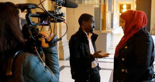 plaintiff Bocar, center, is interviewed by the media at the Paris appeals court in Paris, France (AP Photo)