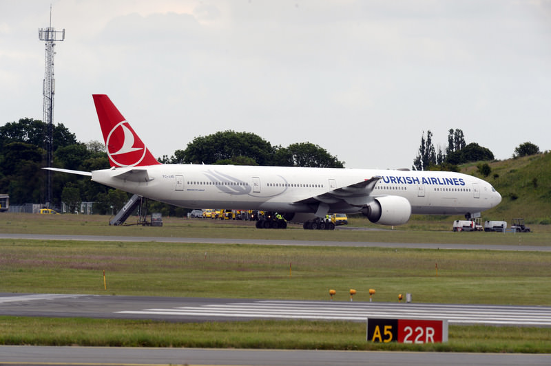Danish police says a New York-bound Turkish Airlines plane made an emergency landing at Copenhagen's international airport after an old camera bag, possibly forgotten by a passenger, caused a bomb scare. (AP Photo)