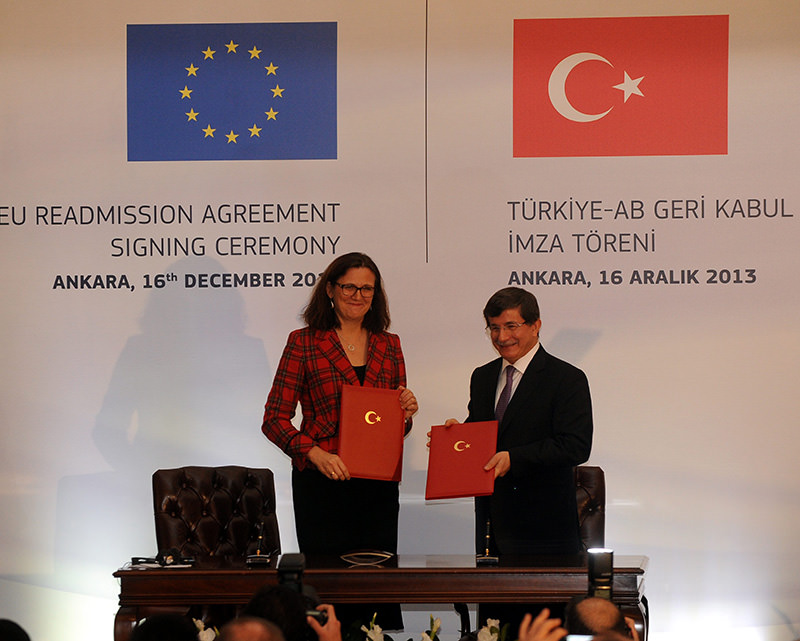 European home affairs Commissioner, Cecilia Malmstrom, Turkeyu2019s then Foreign Minister Ahmet Davutou011flu signing readmission agreement for Turkish citizens in Belgium, Dec. 04, 2013