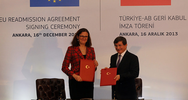 European home affairs Commissioner, Cecilia Malmstrom, Turkey's then Foreign Minister Ahmet Davutoğlu signing readmission agreement for Turkish citizens in Belgium, Dec. 04, 2013