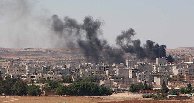 Smoke and flames rise from Kobani is seen from the outskirts of Suruç district of Şanlıurfa district.