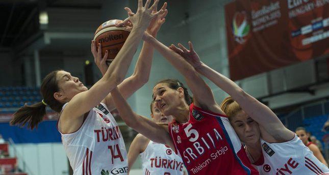 Şaziye İvegin, left,and Bahar Çağlar, right, of Turkey challenge Sonja Petrovic of Serbia for the ball.