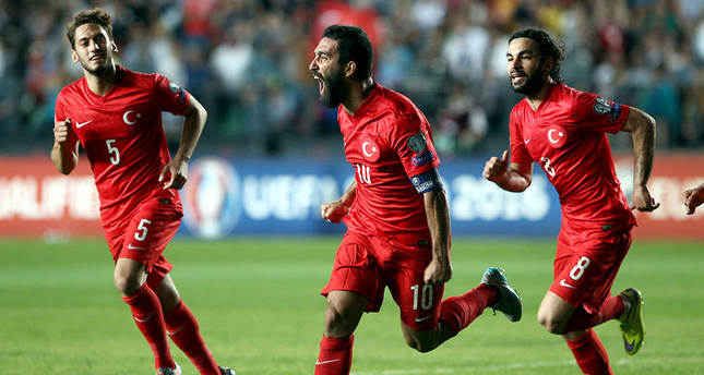 Arda Turan (center) celebrates his goal against Kazakhstan in the match played on June 12