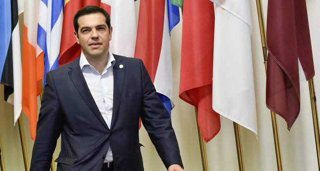 Greek Prime Minister Alexis Tsipras arrives to speak to journalists after an EU summit at the EU headquarters in Brussels on June 26, 2015 (AFP Photo)