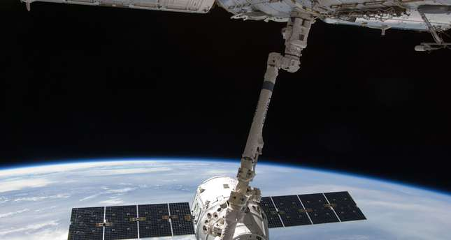 The SpaceX Dragon commercial cargo craft is grappled by the Canadarm2 robotic arm at the International Space Station (Reuters Photo)