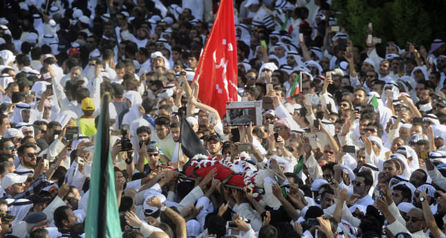 Thousands of Sunnis and Shiites from across the country take part in a mass funeral procession for 27 people killed in a mosque attack in Kuwait, Saturday, June 27, 2015 (AP Photo)