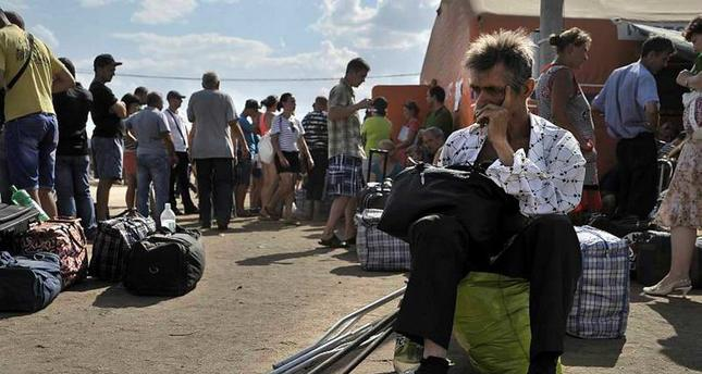 Refugees from southeastern Ukraine wait after arriving at a refugee camp in the Russian border town of Donetsk near Rostov Oblast.