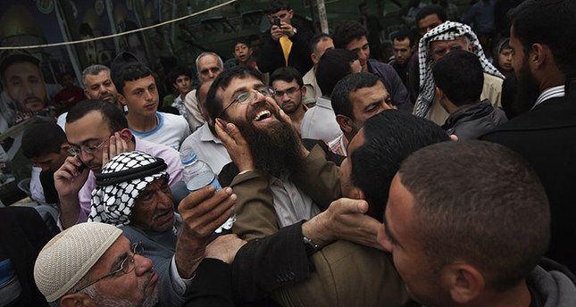 In this April 18, 2012 file photo, Palestinian Khader Adnan, center, is greeted by Palestinians during a celebration ceremony after his release from Israeli jails, in the West Bank village of Arrabeh (AP Photo)