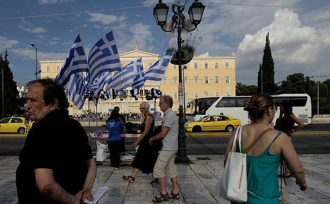 Greek parliament seen in the bacground with supporters of No in referendum in famous Syntagma (Constitution) Square of Athens (EPA Photo)