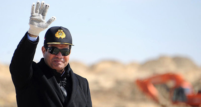 In this Sunday, Feb. 22, 2015, file photo, provided by the Egyptian Presidency, Egyptian President Abdel-Fattah el-Sissi waves during a visit to the Suez Canal in Ismailia, Egypt (AP Photo)