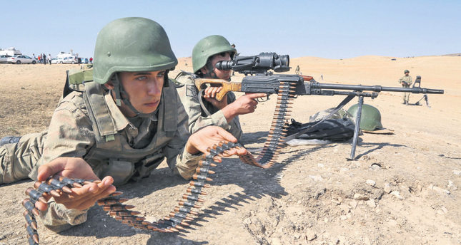 Turkish soldiers take position a few hundreds meters from the border in Murşitpınar near Suruç, as fighting intensifies between Syrian Kurdish forces and ISIS.