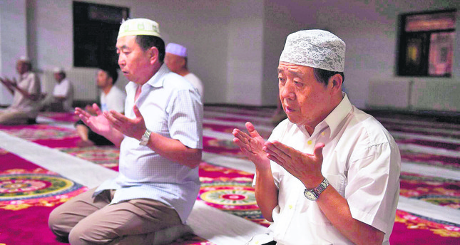 Two Uighurs pray in a mosque in Xinjiang. The region is suffering from increasing oppression from the Chinese government.
