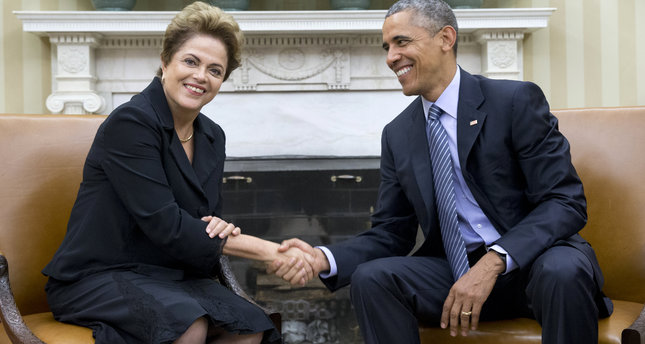 President Barack Obama shakes hands with Brazilian President Dilma Rousseff in the Oval Office of the White House in Washington, Tuesday, June 30, 2015.  (AP Photo)