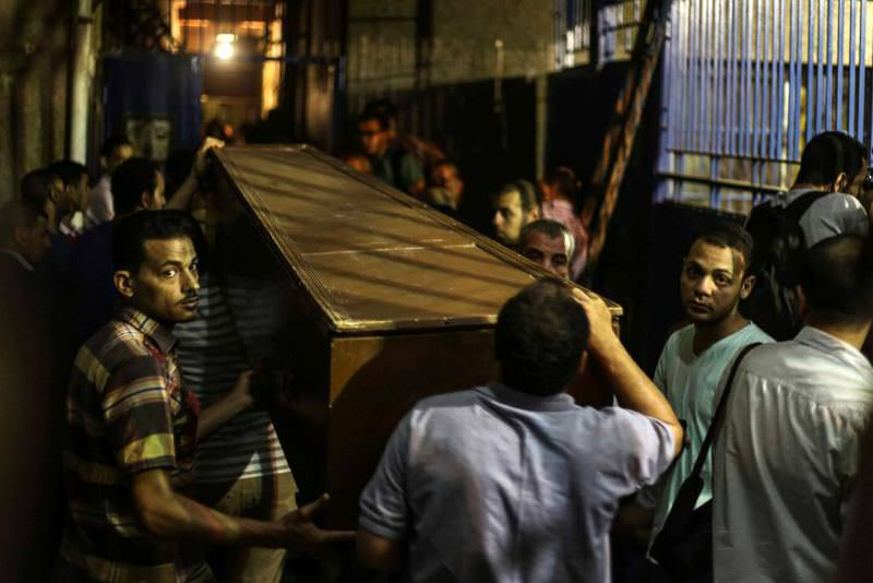 Relatives of Muslim Brotherhood leaders who were killed in a raid on a Cairo apartment carry one of their coffins.