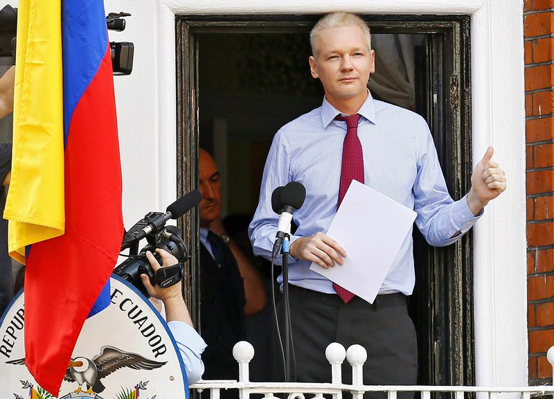 A file picture dated 19 August 2012 of Wikileaks founder Julian Assange giving a thumbs up prior to delivering a statement on the balcony inside the Ecuador Embassy where he has sought political asylum in London (EPA Photo)
