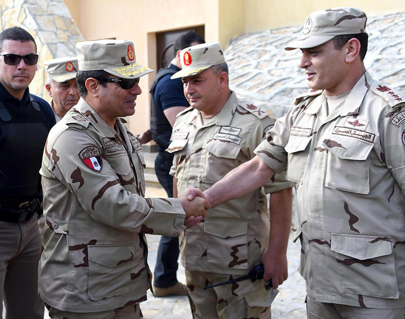 n this picture provided by the office of the Egyptian Presidency, Egyptian President Abdel-Fattah el-Sissi, second left, greets members of the Egyptian armed forces in Northern Sinai, Egypt, Saturday, July 4, 2015 (AP Photo)