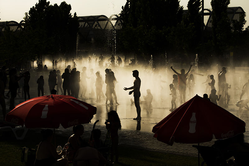 People cool down in a fountain beside Manzanares river in Madrid, Spain, Tuesday, June 30, 2015 (AP Photo)