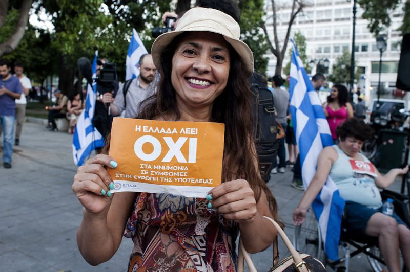 A woman celebrates at Klafthmonos Square in Athens on July 5, 2015 after the first exit-polls of the Greek referendum. (AFP Photo)