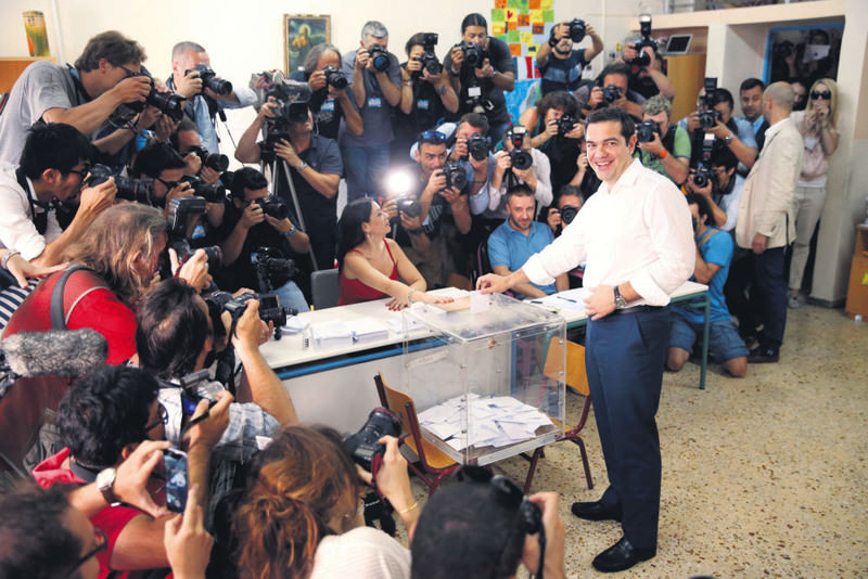 Greek Prime Minister Alexis Tsipras casts his ballot at a polling station in Athens on Sunday.