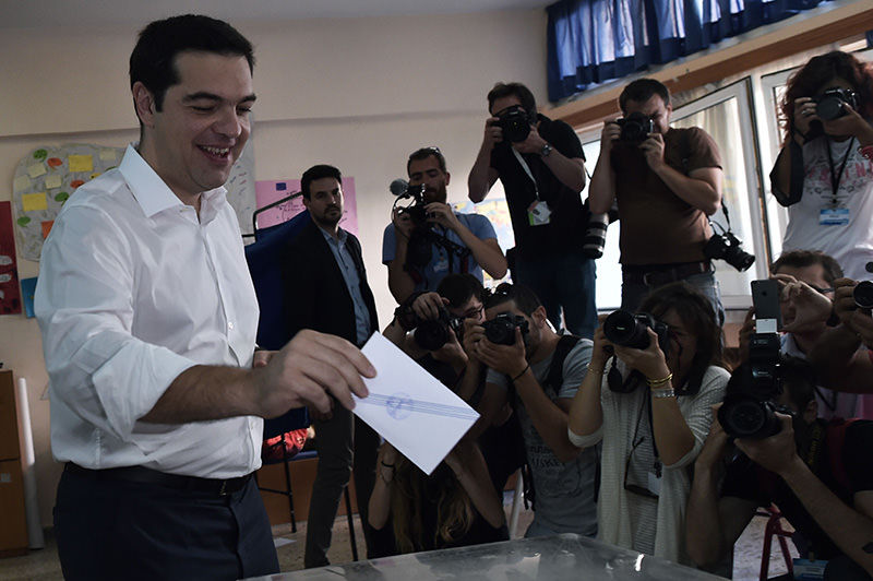 Greek Prime Minister Alexis Tsipras votes during the Greek referendum in Athens on July 5, 2015 (AFP Photo)