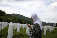 Hajra Catic prays near the grave of her husband in Memorial center in Potocari near Srebrenica, Bosnia and Herzegovina, June 23, 2015 (Reuters Photo)