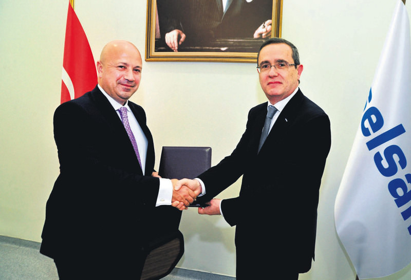 ASELSAN CEO Faik Eken (L), and Turkcell CEO Kaan Terziou011flu (R) shaking hands to formalize the collaboration in 5th generation mobile communication and network technologies