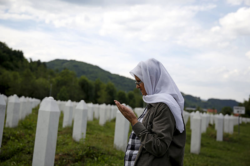 Hajra Catic prays near the grave of her husband in Memorial center in Potocari near Srebrenica, Bosnia and Herzegovina, June 23, 2015 (Reuters Photo)