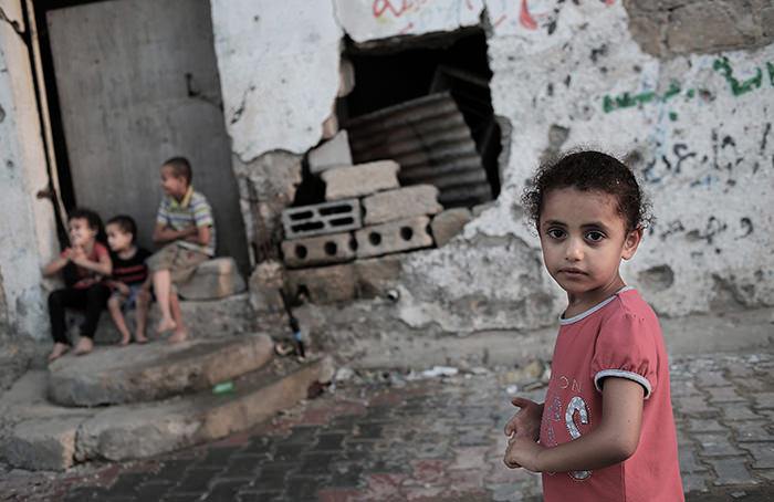 Palestinian children play near their destroyed home damaged during the 2014 Israel-Gaza conflict in Al Shejaeiya neighbourhood in the east of Gaza City, 05 July 2015. (EPA Photo)