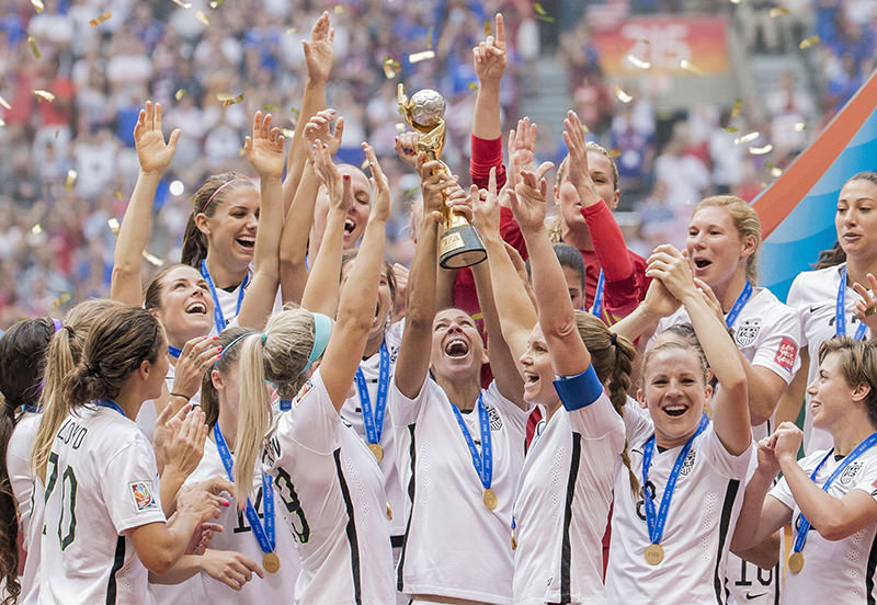 USA's team players celebrate their victory with the World Cup trophy at the end of the FIFA Women's World Cup 2015 final match between USA and Japan, in Vancouver, Canada, 05 July 2015. (EPA Photo)