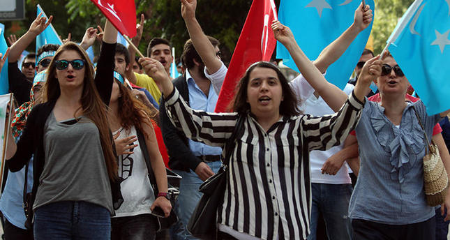 Turkish protestors demonstrate in front of the Chinese Embassy in Ankara, on July 5, 2015, to denounce the Chinese government's policies on Uyghur Muslims (AFP Photo)