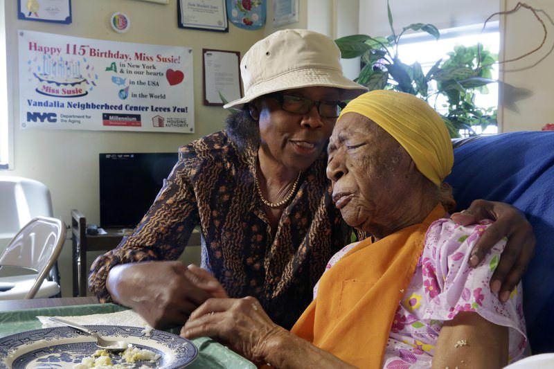 In this Monday, June 22, 2015 photo, Susannah Mushatt Jones, 115, right, is embraced by her niece Lois Judge in her room at the Vandalia Avenue Houses, in the Brooklyn borough of New York. (AP Photo)