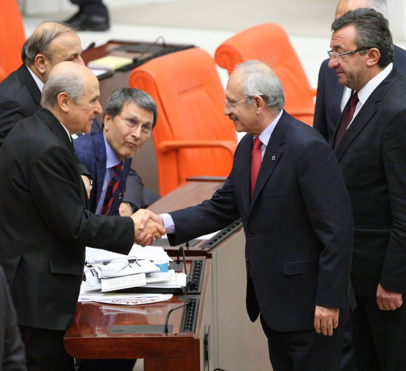 MHP Chairman Bahu00e7eli shaking hands with CHP Chairman Ku0131lu0131u00e7darou011flu during the final round of the Parliament speaker elections.