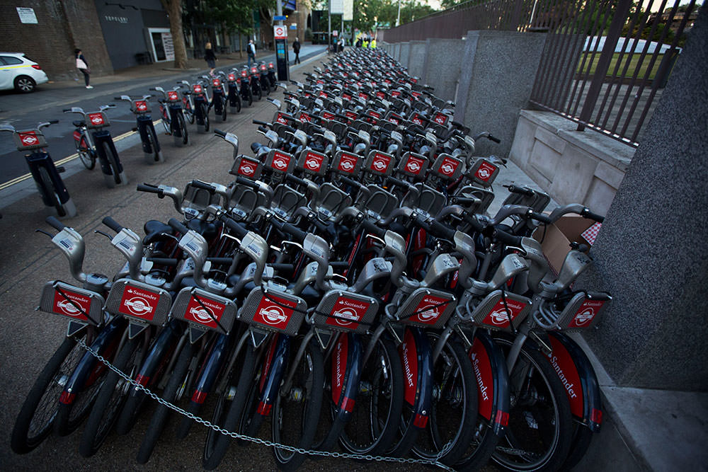 During a 24 hour London underground train strike, a stockpile of hire cycles from a city bike-sharing scheme stand ready at the start of the morning rush hour in London, Thursday, July 9 (AP Photo)