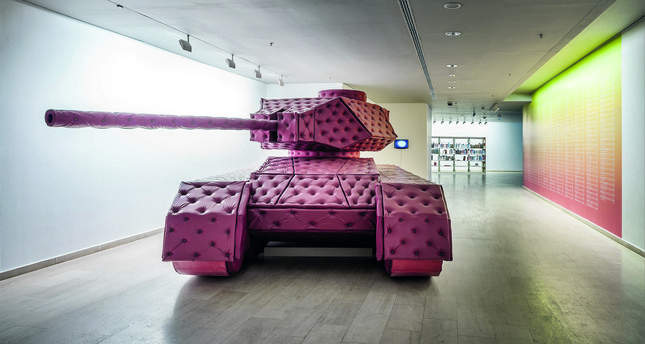Tan Mavitan's Tank is a life-size model, made from padded leather and metal. Filling the first floor of the exhibition, it is a disturbing tongue-in-cheek reminder of the power, as well as fragility, of military and state bureaucracy.