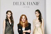 Dilek Hanif (C), the first Turkish fashion designer admitted to the official Paris Haute Couture Week.