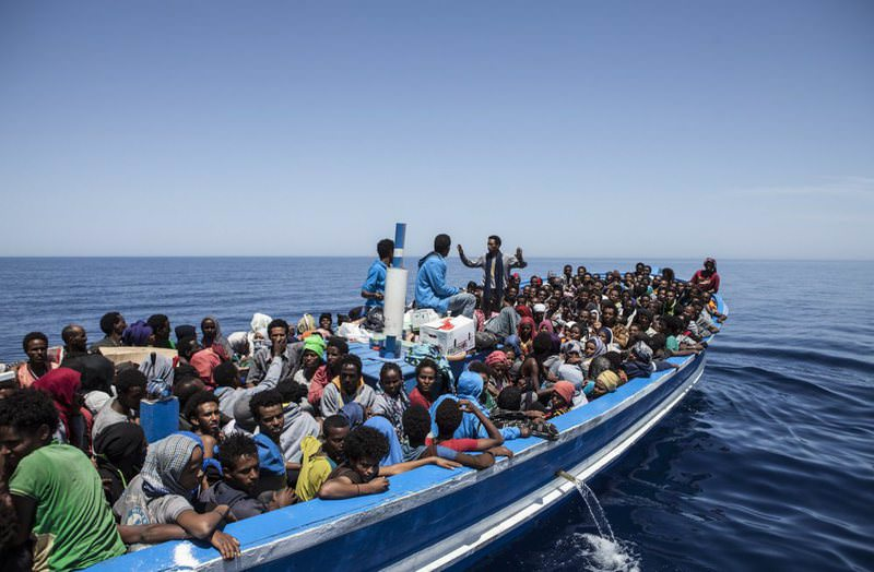 This photo taken on May 3, 2015 and released by the MOAS (Migrant Offshore Aid Station) shows migrants aboard a wooden boat on the Mediterranean Sea.